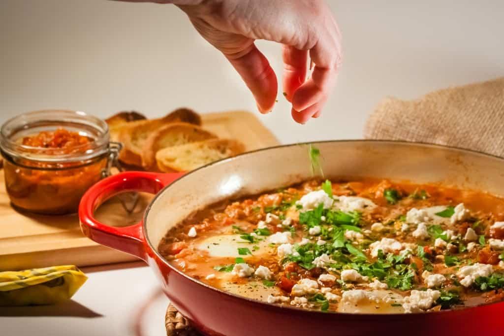 shakshuka - eggs in spicy tomato sauce action