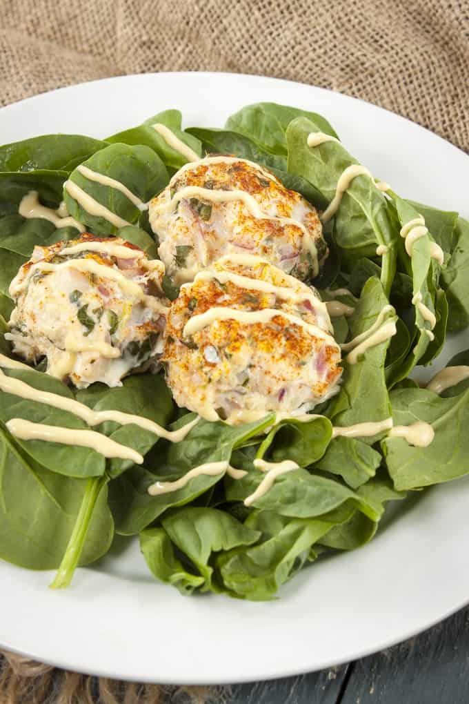 Salmon-crab cake sliders with zesty Creole mustard sauce