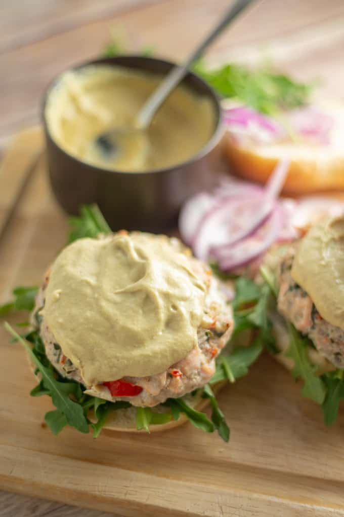 Mouthwatering salmon crab burgers with zesty creole mustard sauce.